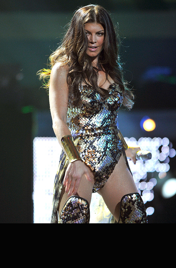 Bodysuit, boots featuring 8500 hand-sewn aluminum scales, Swarovski crystals<br>2010 American Idol Gives Back <br>Stylist: B Akerlund
