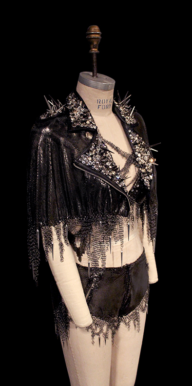 Gunmetal mesh motorcycle cape, bra and shorts, crystal detailing<br>Styling B Akerlund ~ Director Jonas Akerlund