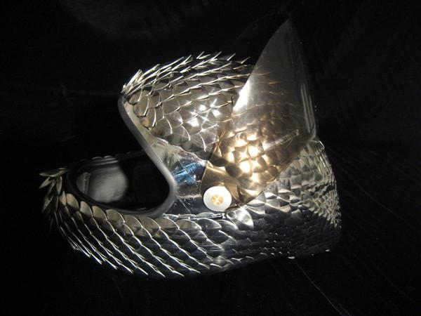 Metal scaled helmet<br>Sticky & Sweet World Tour, 2008-9 <br>Stylist Arianne Phillips
