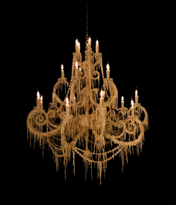 Synthetic wax draped chandeliers<br>Hand-dripped polymer 'wax', custom steel chandeliers, lighting<br>Barnett dining room 2016