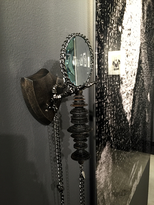 Hand turned mahogany handle on custopmagnifying glass with sterling silver and diamond skull chain<br>Lynn Goldsmith solo exhibition<br>Mouche Gallery, Beverly Hills, 2015